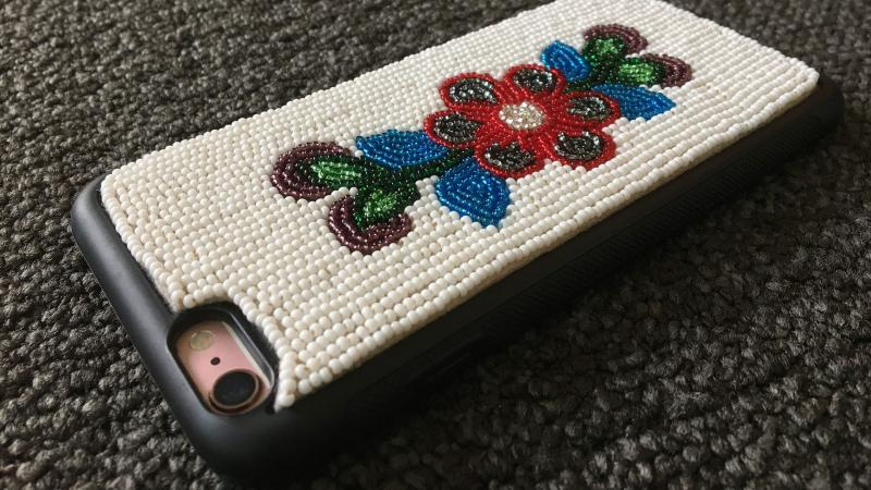 Cell phone with traditional embroidery