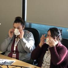 Frontline staff participate in fit testing of masks, as part of COVID-19 preparedness efforts.